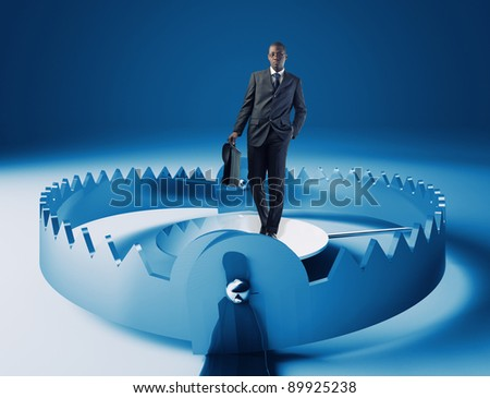 standing young businessman on 3d trap