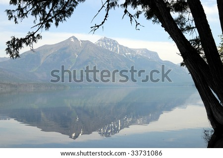 Stanton Mountain and Mount Vaught reflected on the calm surface of Lake McDonald in the Glacier National Park in Montana, northwestern USA.