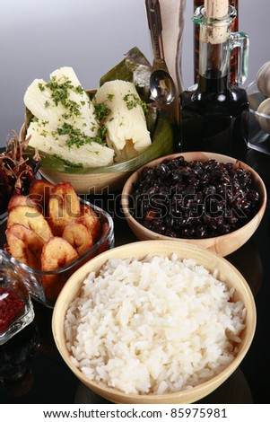 Staple latino sides, manioc, rice, plantains, and black beans