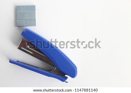 Stapler and core staple