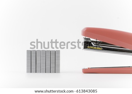 Stapler and metal staple concept over white background -