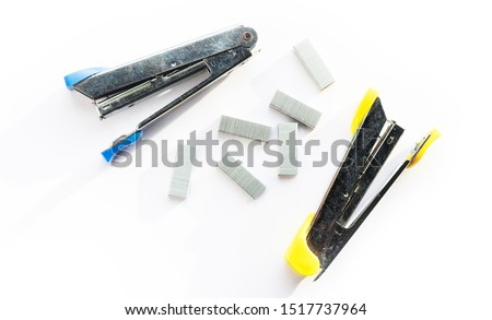 stapler and Staples on white background, Office accessory background, School accessory.