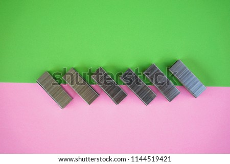 Stapler clip in decoration with copy space on colorful paper. office desk concept