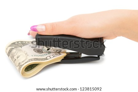 Stapler, dollars and a female hand. On a white background.