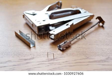 stapler industrial on wood