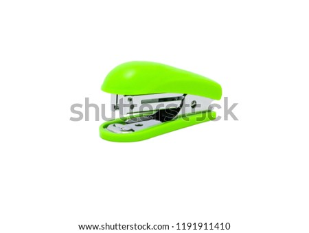 Stapler, office equipment green color isolated on a white background, with clipping path.