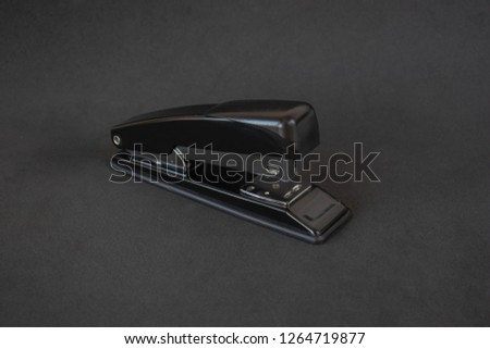Stapler on a black background