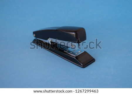 Stapler on a blue background