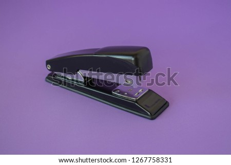 Stapler on a purple background