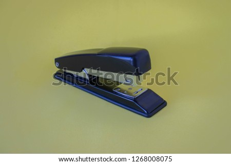 Stapler on a yellow background