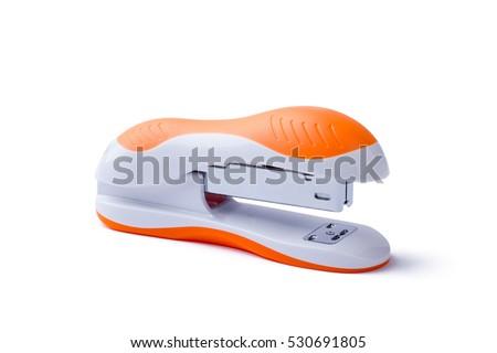 Stapler on white background. Side close-up view of stapler. Orange stapler isolated. Office equipment for paperwork.