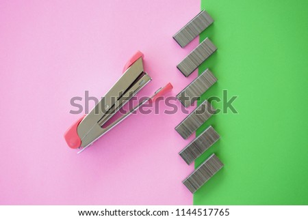 Stapler paper and colorful paper on desk. conceptual image for office desk and stationery.