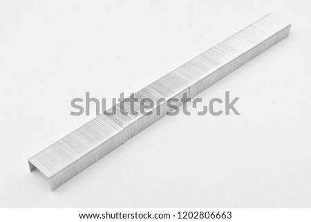 stapler pins on white background