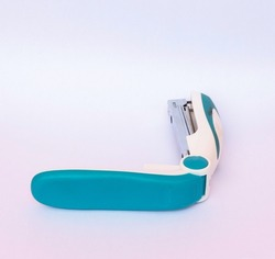 stapler white color combination of turquoise green isolated on a white background. copy space concept. office and school equipment.