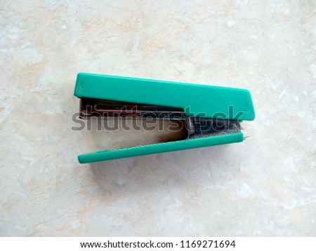 Staplers are used to unify paper