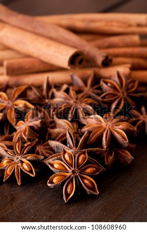 Star anise and cinnamon close up on wooden table - stock photo