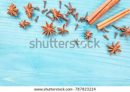 Star anise, cinnamon sticks and cloves on a nintage background. Selective focus.