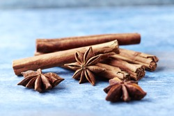 Star anise with cinnamon. Christmas spices on rustic wooden background. Copy space.