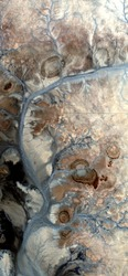 star artery, vertical abstract photography of the deserts of Africa from the air, aerial view of desert landscapes, Genre: Abstract Naturalism, from the abstract to the figurative,