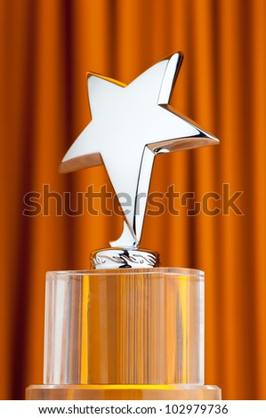 Star award against curtain background - stock photo