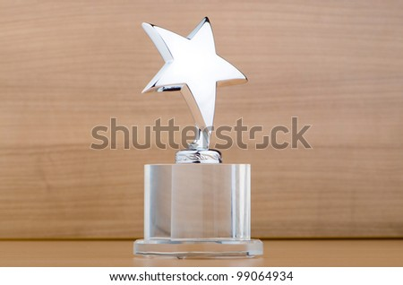 Star award against wooden background