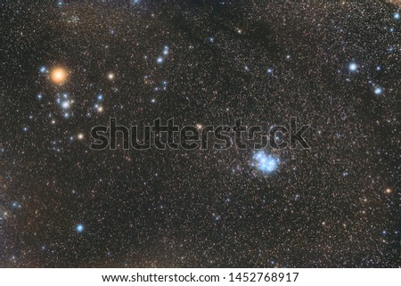 star clusters of Hyades and Pleiades. Cosmic light and cosmic dust. Photo space. Red hydrogen nebula and blue stars. Astronomical observations of space.