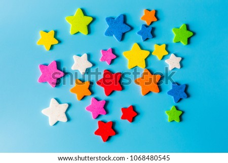 Star eva foam for decoration isolated on blue background, decorative foamy material for creating artificial handmade star, View from above.