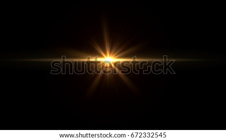 Photo of  star flare in black background.