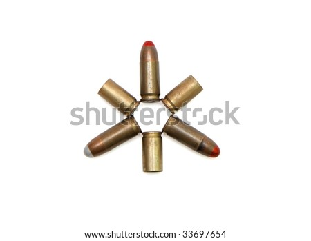 Star made of 9mm Parabellum cartridges and spent cases isolated