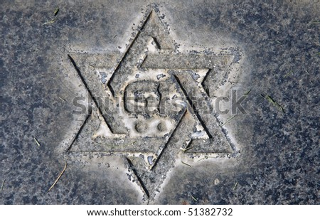 Star of David on old grunge granite tombstone. Old Jewish cemetery in California