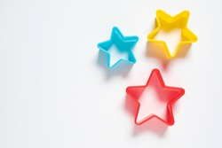 Star plastic Resting on a white background. Multicolored star plastic. Cookie cutter star shape on white background.