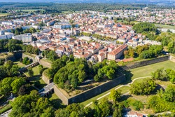 Star-shaped bastions and fortified walls of Ville Neuve (New town) of Longwy (Langich, Longkech) city in Lotharingia and Upper Lorraine, France. Aerial drone view of one of Fortifications of Vauban.