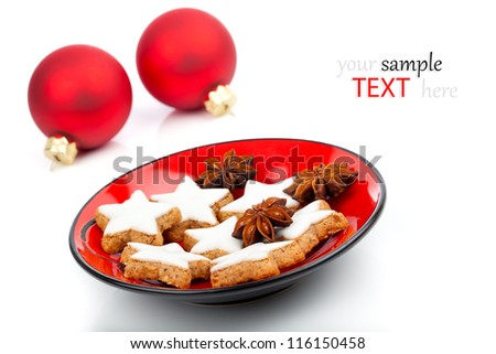 star shaped biscuit on red plate, on white background