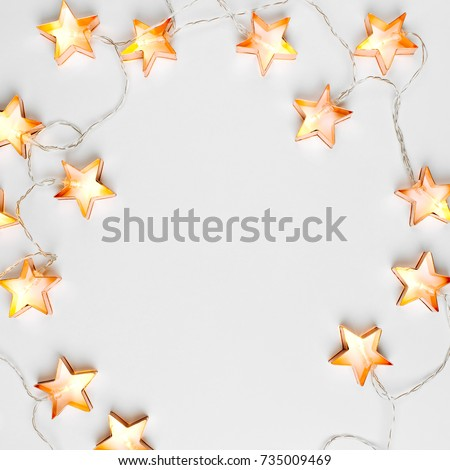 Star shaped Christmas lights frame. Flat lay, top view
