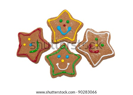Star shaped gingerbread Christmas cookies on white background