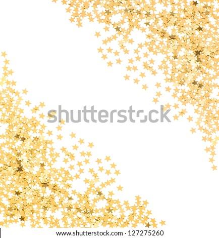 star shaped golden confetti on white background. festive background