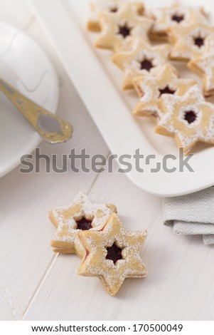 Star shaped sugar cookies on white serving plate