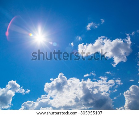 star-shaped sun in blue sky with light clouds #305955107
