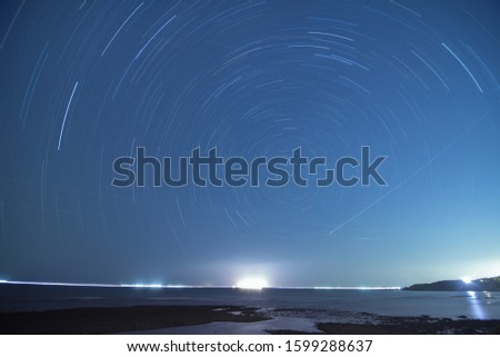 Star trail on the north coast of Taiwan, can also see boat lights on the distant ocean, and the airplane light trails between stars.
