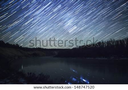 star trails at night and the river