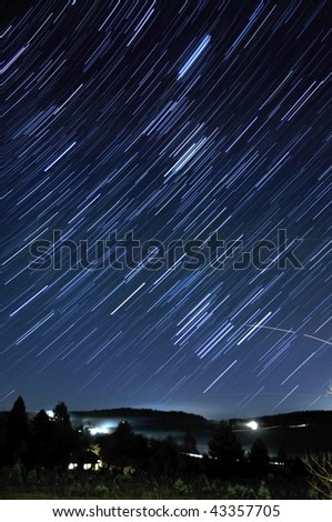 Star Trails Long Exposure At Night. Located in a country rural part of Oregon. Taken December 2009. - stock photo
