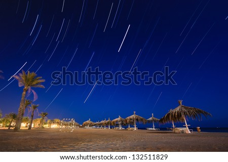 Star trails on a deserted tropical beach at night