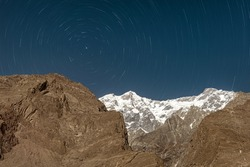 star  trails on the mountains in hunza valley