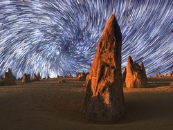 Star trails over the landscape of the Pinnacle desert limestone formations at night near Cervantes in Western Australia.