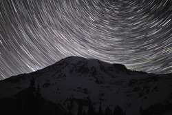 Star Trails Spin Above Mt Rainier In Washington State