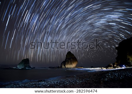 Star trails.  Stacking of long exposure images taking on a starry night to create star trails.  Location at Tanjung Papuma, East Java, Indonesia. #282596474