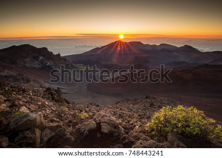 Starburst sunrise shot on the summit of Haleakala Volcano overlooking the volcanic crater  in Haleakala National Park on Maui in Hawaii #748443241