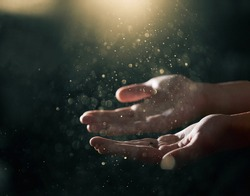 Stardust and magic in humanhands. Magic particles on the palms