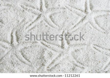 starfish imprints on sand