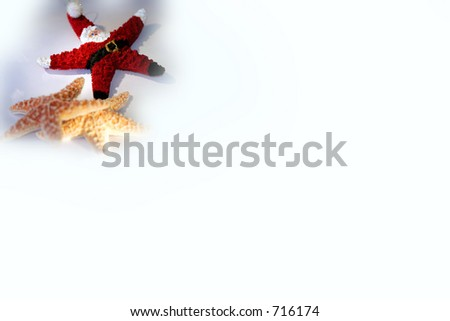 Starfish Santa Claus with two other starfish - represents Christmas season in tropical or warm locales.